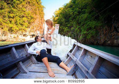 Blonde Bride And Handsome Groom On Boat