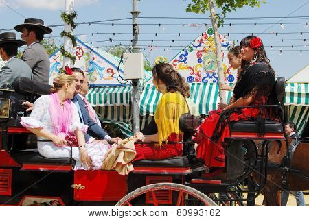 Spanish family in a horse drawn carriage.