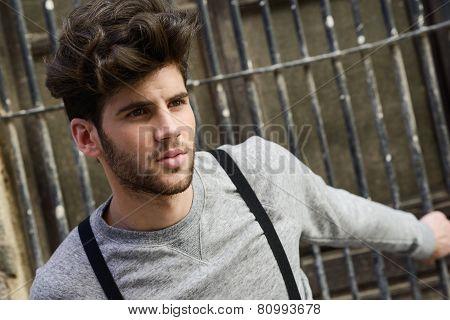 Man Wearing Suspenders In Urban Background