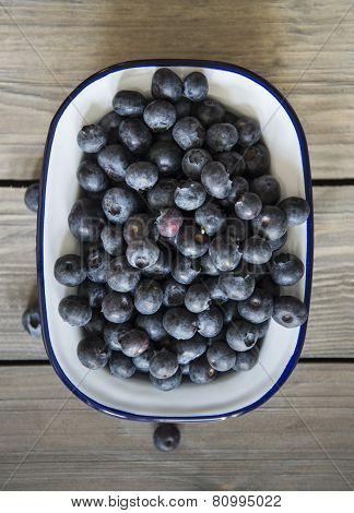 Blueberries In Rustic Kitchen Setting With Old Wooden Background