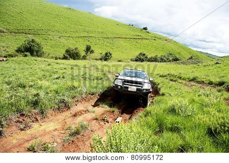 4x4 Vehicle Traveling on Dangerous Dirt Road in Nyika Plateau, Malawi, Africa
