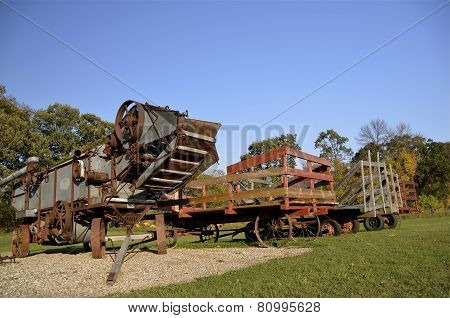 Threshing machine and racks for hauling bundles
