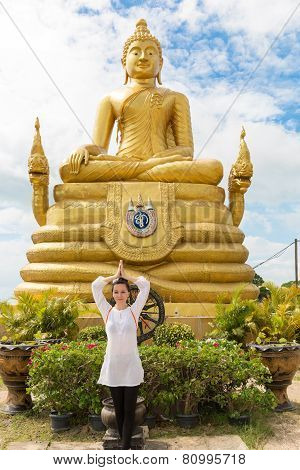 Young  Woman Praying And Meditating Gold Buddha Near, Thailand, Phuket