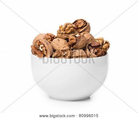 Close up of walnuts bunch in bowl.
