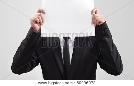 Businessman showing blank paper for communication