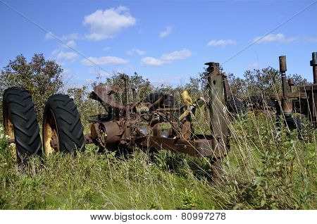 Salvaged tractor in the long grass