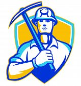 pic of ax  - Illustration of a coal miner with pick ax facing front set inside shield done in retro style - JPG