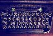 stock photo of typewriter  - an antique typewriter on a wooden table toned with a retro vintage instagram filter effect app or action  - JPG