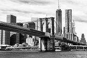 stock photo of bridge  - The Manhattan skyline and Brooklyn Bridge at night seen from Brooklyn Bridge Park in Brooklyn New York - JPG