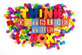 stock photo of thinking outside box  - think outside the box word in colorful stone background - JPG