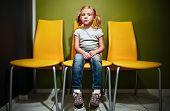 stock photo of redhead  - Little redhead girl waiting in reception room - JPG