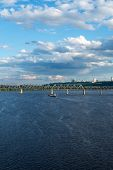 picture of barge  - The barge floating in the blue Dnieper waters against the summer Kyiv landscape - JPG
