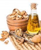 picture of nutcracker  - Walnut nutcracker and bottle with walnut oil isolated on white - JPG