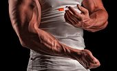 pic of flu shot  - muscular man doing a shot in the biceps steroids pharmacology - JPG