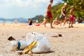 stock photo of environmental pollution  - Garbage on a beach left by tourists environmental pollution concept picture - JPG