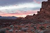 foto of valley fire  - sunset in Valley of Fire state park in Nevada with glowing red sandstone and bright color in the clouds - JPG