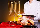 foto of hanukkah  - Festive ceremony on Hanukkah on dark background - JPG