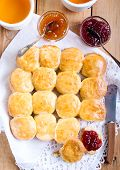 image of buttermilk  - Buttermilk scones with strawberry jam on table - JPG