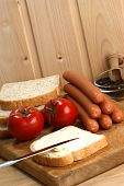 Sausage, Also Known As Knackwurst, On A Timber Board poster