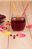pic of pomegranate  - Pomegranate juice in a glass and ripe pomegranate grains - JPG