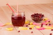 image of pomegranate  - Pomegranate juice in a glass and ripe pomegranate grains - JPG