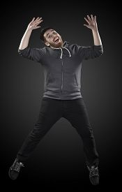 picture of wacky  - Full Length Shot of Handsome Young Man Wearing Casual Shirt in Wacky Pose - JPG
