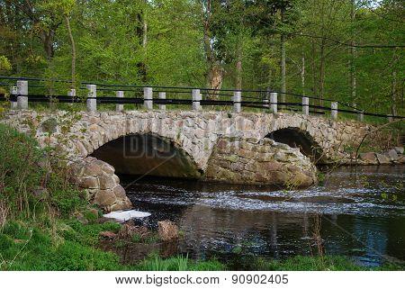 Ancient Bridge Over A Small River