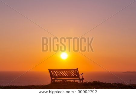 Bench in garden at sunrise in spring season
