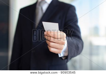 Detail of a businessman giving a business card