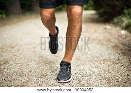 Man running in a park, legs detail