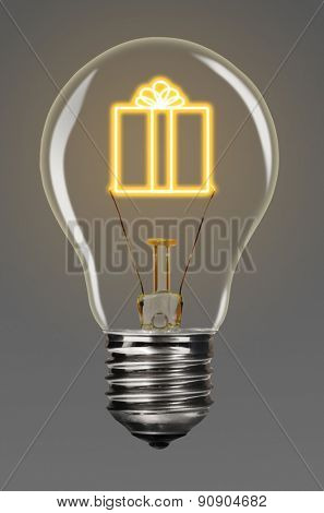 bulb with glowing gift inside of it, creativity concept