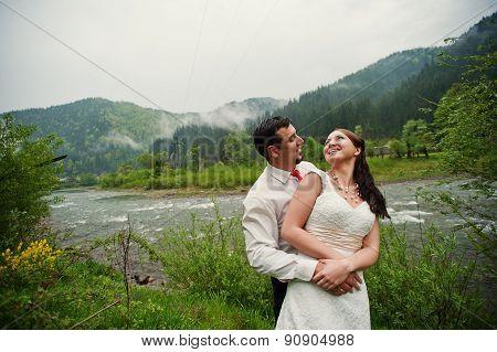 Wedding Couple Near River With Fog
