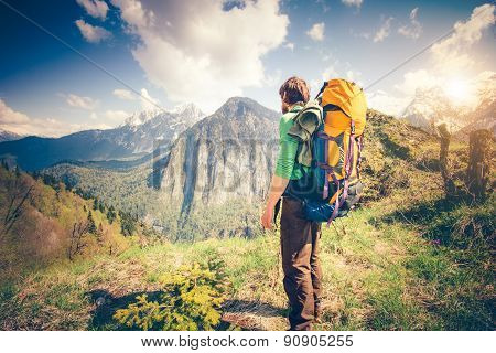 Young Man Traveler with backpack relaxing outdoor