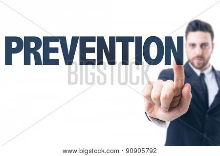 Business man pointing the text: Prevention