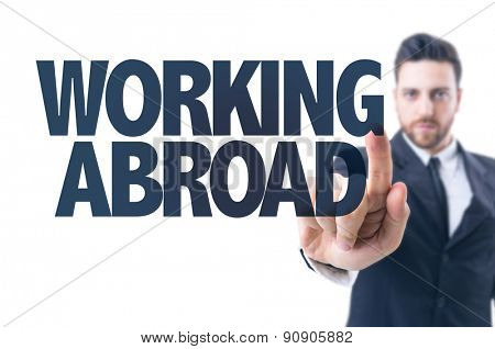 Business man pointing the text: Working Abroad