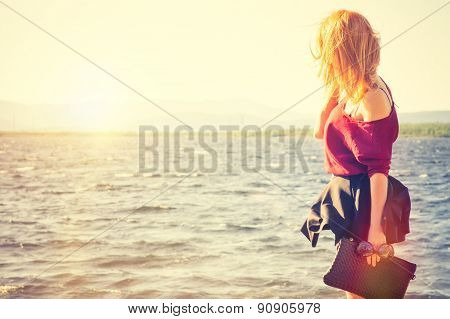 Young Woman holding bag walking outdoor Lifestyle Fashion Travel concept