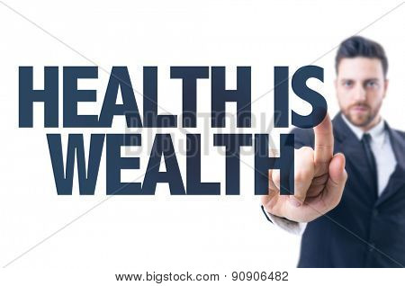 Business man pointing the text: Health is Wealth