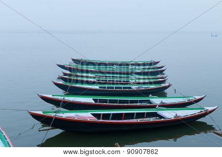 Boats In A Row On Sacred River Ganges Foggy Morning. Varanasi