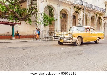 Classic American yellow car on street of Havana