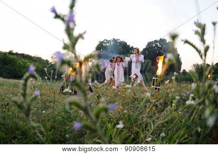 Ukrainian Girl In A White Sundress With A Wreath Of Flowers On Her Head Green Grass