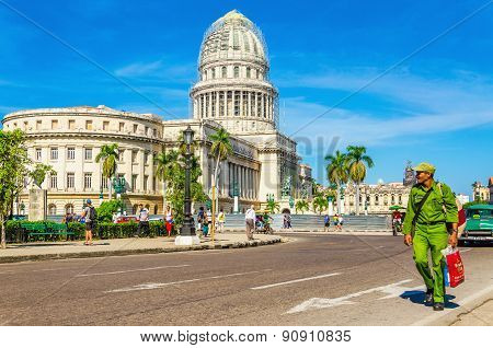 HAVANA, CUBA - DECEMBER 2, 2013: Cuban soldier against the Capitol in Havana, Cuba