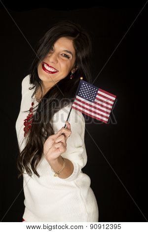 Pretty Dark Haired Woman Smiling Holding An American Flag