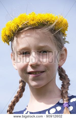 Young Girl Portrait In Yellow Dandelion Garland