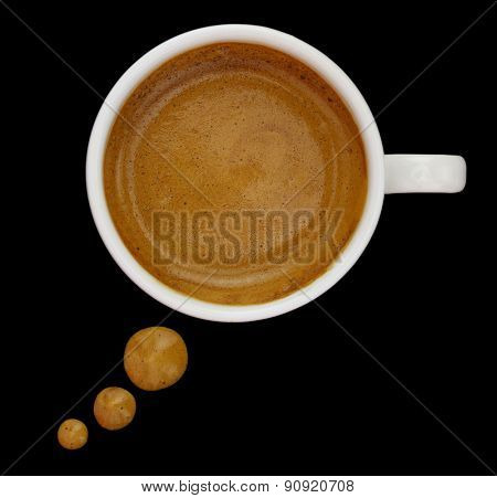 Coffee cup with drops forming a text bubble isolated on black