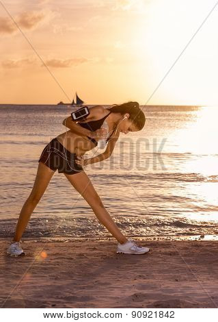 Attractive woman stretching on the beach