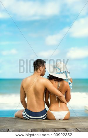 Couple on a tropical beach at Bali, back view