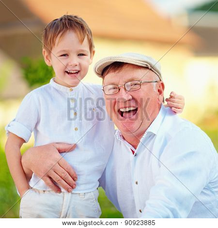 Portrait Of Happy Grandpa And Grandson, Outdoors