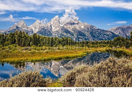 Scenic View Of Grand Teton Mountains  With Water Reflection