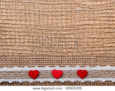 Red Hearts On Abstract Cloth Background