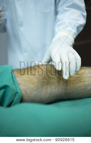 Surgeon Doctor Injecting Patient In Hospital Clinic